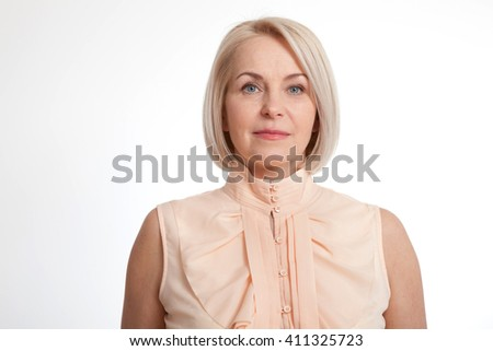 Friendly smiling middle-aged business woman isolated on white background - stock photo