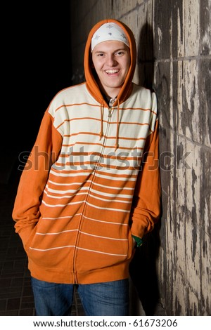Friendly teenager boy looking in the camera - stock photo