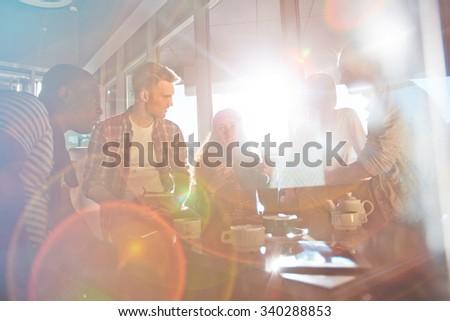 Friendly teens having conversation indoors - stock photo