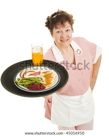 Friendly waitress serving a turkey dinner on her tray.  Isolated on white. - stock photo