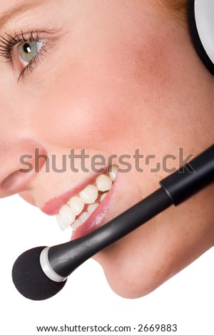 Friendly woman smiling with headset. View from the side. Diagonal. Isolated on white. - stock photo