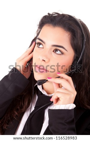 Friendly young beautiful telephone operator at work - stock photo