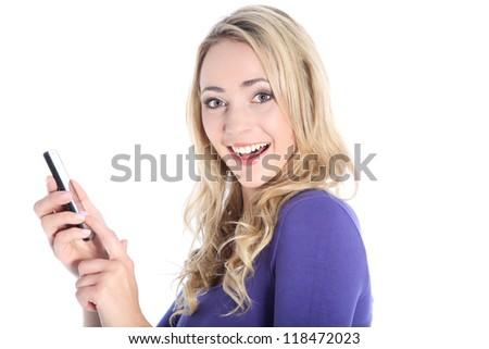 Friendly young blonde woman dialing on a cell phone isolated on white - stock photo