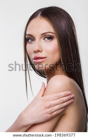 friendly  young woman portrait studio shot  - stock photo