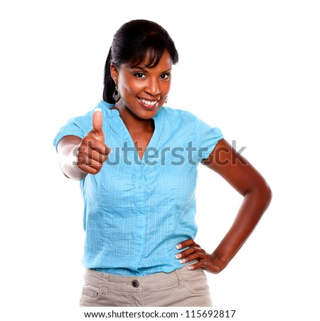 Friendly young woman saying great job on blue shirt against white background - stock photo