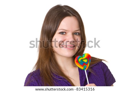 Friendly young woman with lollipop - isolated on white background - stock photo