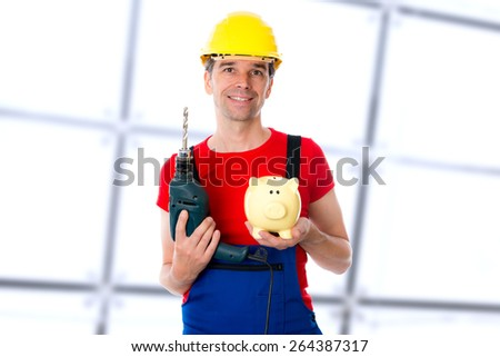 friendly young worker with drill and piggy bank - stock photo