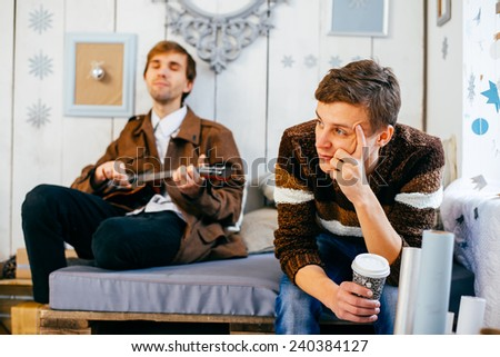 Friends and guitar - stock photo