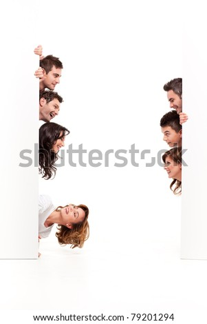 friends between two blank boards looking at eachother - stock photo