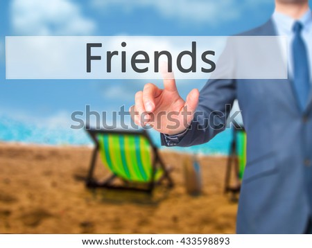 Friends - Businessman hand pressing button on touch screen interface. Business, technology, internet concept. Stock Photo - stock photo