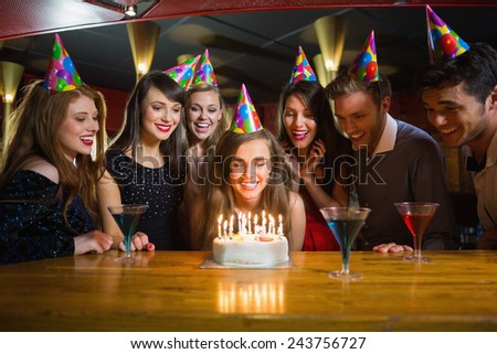 Friends celebrating a birthday together at the nightclub - stock photo