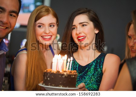 Friends celebrating birthday together in a classy bar - stock photo