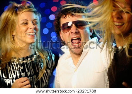 Friends clubbing - stock photo