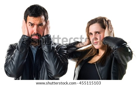 Friends covering their ears - stock photo
