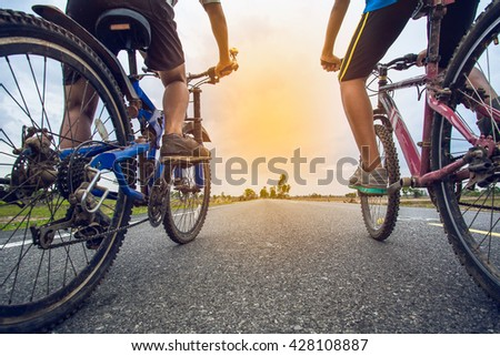 Friends cycling together - stock photo