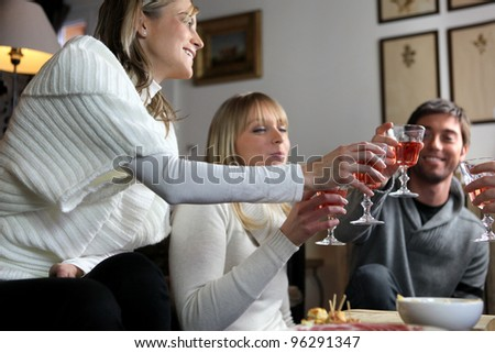 Friends drinking wine at party - stock photo