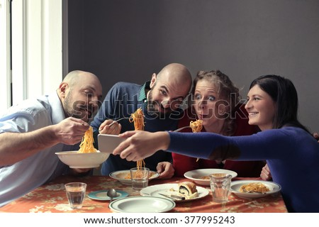Friends eating together - stock photo
