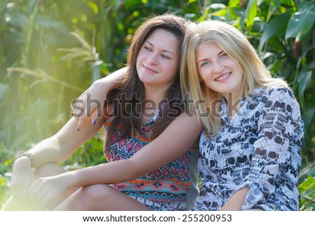 Friends enjoy good sunny day outdoors together - stock photo