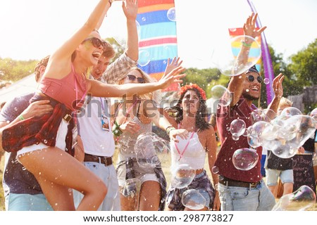 Friends enjoying a performance at a music festival - stock photo