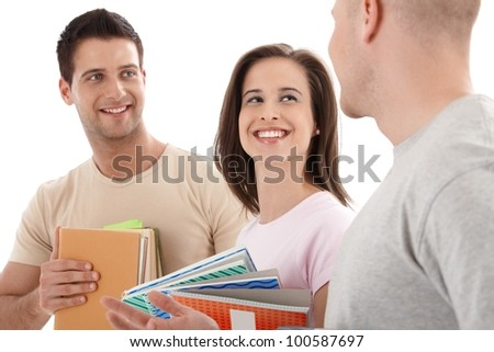 Friends from college chatting, laughing with notes and books handheld, isolated on white. - stock photo