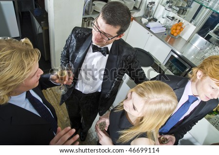 Friends gathering together at a champagne reception in a bar - stock photo