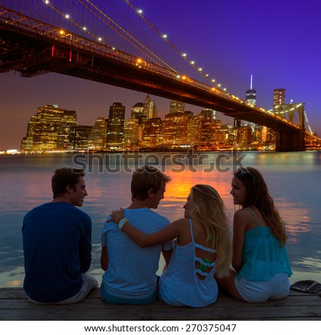 Friends group rear view at sunset happy fun in New York Manhattan photo mount - stock photo