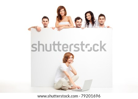 friends group showing blank banner woman laptop - stock photo