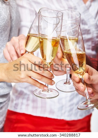 Friends hands toasting with champagne - stock photo