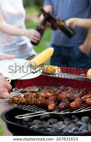 Friends having a good time on grill party - stock photo