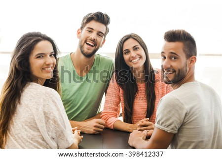 Friends having a great day at the coffee shop - stock photo
