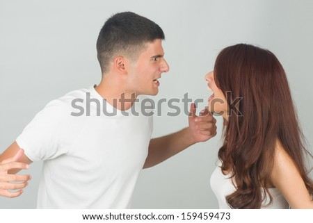 Friends having argument and yelling each other. - stock photo