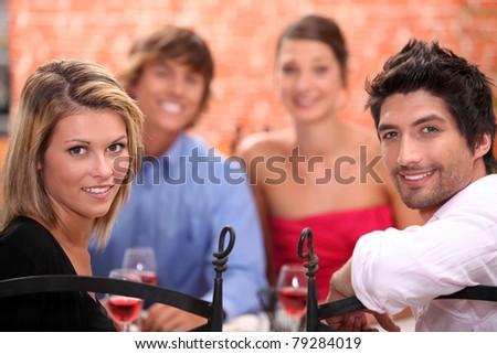Friends having dinner - stock photo