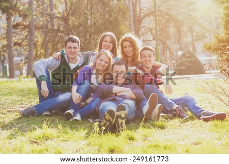 Friends having fun in the park - stock photo
