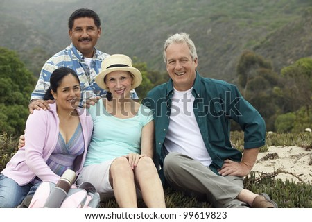 Friends Having Picnic at Beach - stock photo