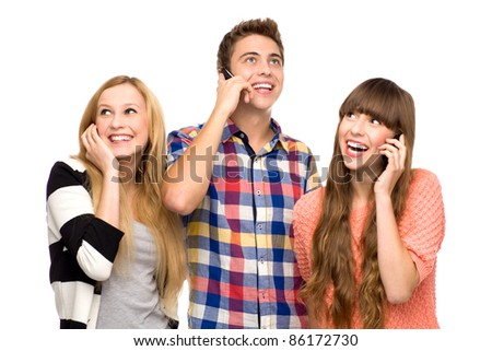 Friends holding mobile phones - stock photo