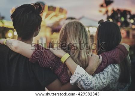 Friends Huddle Happiness Amusement Park Festival Concept - stock photo