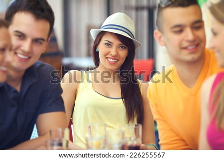 Friends in a cafe - stock photo