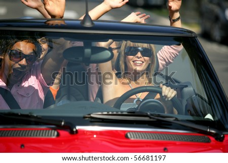 Friends in a car - stock photo