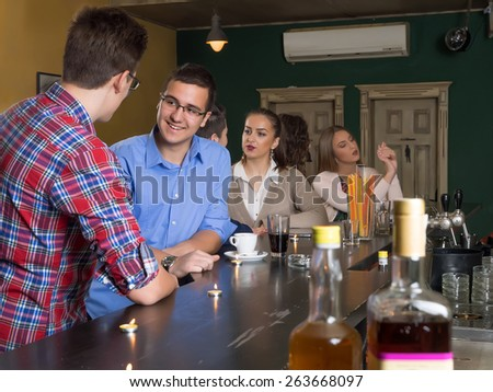 Friends in caffe restaurant - stock photo