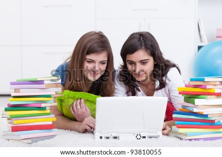 Friends in college together - beautiful girls study with books and laptop - stock photo