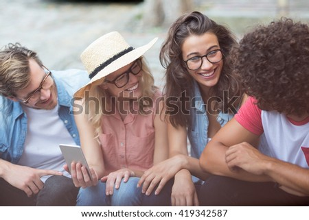 Friends in spectacles interacting with each other - stock photo