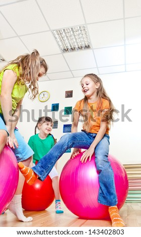 Friends jumping on gymnastic balls - stock photo