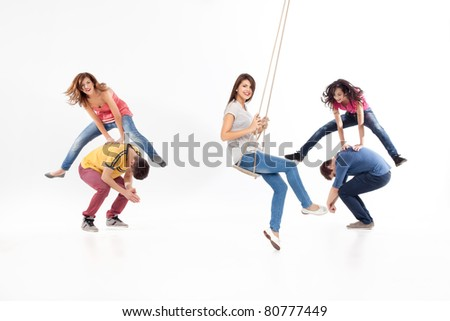 friends jumping, swinging, playing, having fun - stock photo
