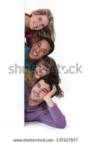 Friends laying by advertising - stock photo