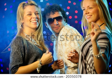 Friends partying in the club - stock photo