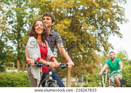 friends riding a bike - stock photo