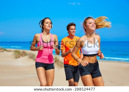 friends running on the beach happy in summer sunny day - stock photo