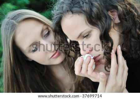 Friends series - detail of two teenage girls, one comforts and regrets another - stock photo