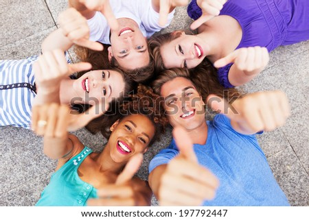 Friends showing thumbs up  - stock photo