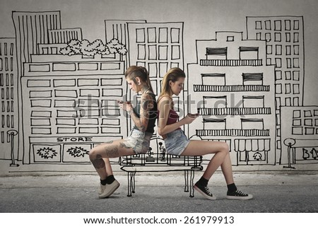 Friends sitting on a bench  - stock photo